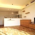 落ち着いた黒い箱を組み合わせた外観。 閉鎖的な外観から室内へ入ると天井の高いリビングが外観とは対照的な明るい内部空間を構成する。 居室全ての床が無垢材でつくられ、使えば使うほど馴染む、天然木という素材の本質感を感じられる住宅が完成した。